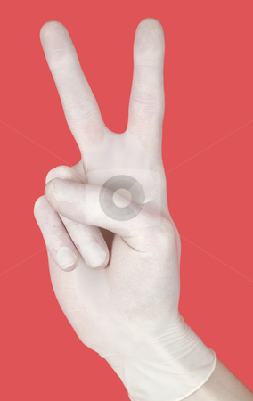 Gesture on red stock photo, Hand in glove showing gesture victory on red by Alexey Romanov