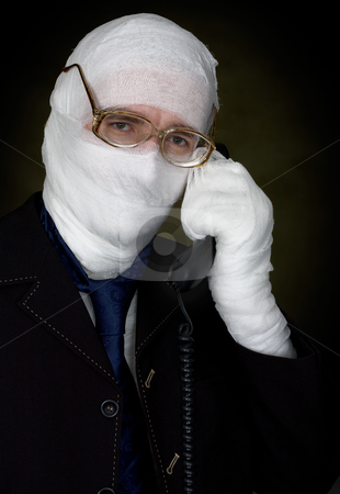 Man in bandage calling on phone stock photo, Man in bandage with eyeglasses  calling on phone by Alexey Romanov