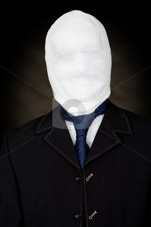 Man in bandage and the cravat stock photo, Man in bandage and the cravat on black by Alexey Romanov