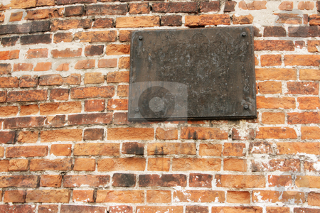 The ancient metal tablet stock photo, The ancient metal tablet on a stone wall by Alexey Romanov