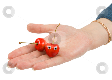 Two sweet cherries on palm stock photo, Two sweet cherries on palm on a white background by Alexey Romanov