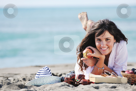 Happy young woman on beach stock photo, happy young woman relax onbeautiful  beach at morning by Benis Arapovic