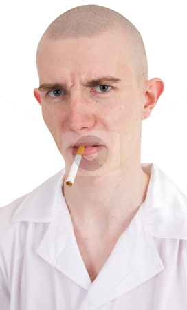Man holding cigarette stock photo, The man holding cigarette in the mouth by Alexey Romanov