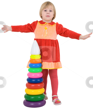 Little girl and toy pyramid stock photo, Little girl and toy pyramid on the white background by Alexey Romanov