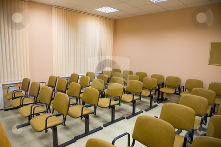 Interior of a conference hall in pink tones stock photo, Interior of a small conference hall in pink tones by Alexey Romanov