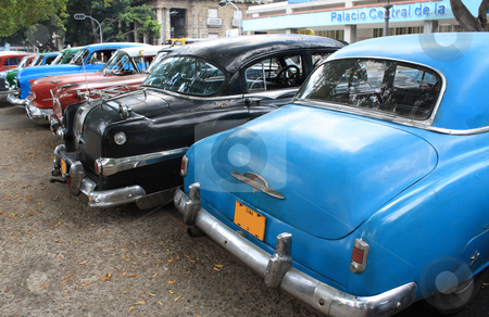 Vintage Cars in Havana, Cuba stock photo, Colourful vintage taxis parked in a street in Havana, Cuba. Rear view. by Brigida Soriano