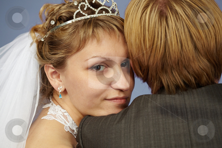 Happy bride on shoulder groom stock photo, Happy bride put her head on his shoulder groom by Alexey Romanov