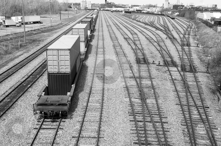 Railway tracks with container caboose stock photo, tracks at a railway with a train carrying commercial container by JOSEPH S.L. TAN MATT