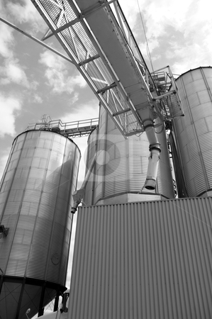 Agriculture industry abstract stock photo, commercial granary steel tank containers used in storage of wheat and grain in agriculture by JOSEPH S.L. TAN MATT