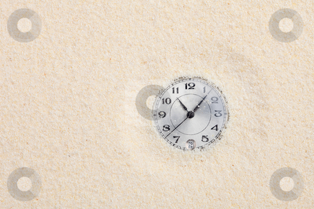 Ancient watch shipped in sand stock photo, The ancient scratched watch shipped in sand by Alexey Romanov