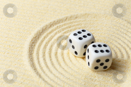 Dices on sand surface - abstract art composition stock photo, Dices on a sand surface - an abstract art composition in yellow tones by Alexey Romanov