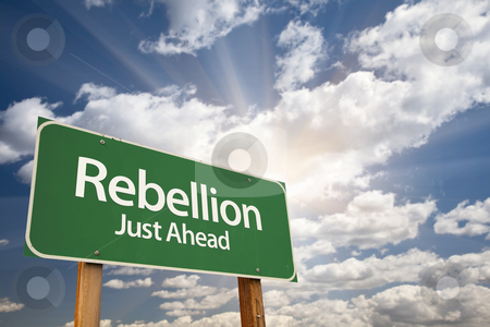 Rebellion Green Road Sign and Clouds stock photo, Rebellion Green Road Sign with Dramatic Clouds, Sun Rays and Sky. by Andy Dean
