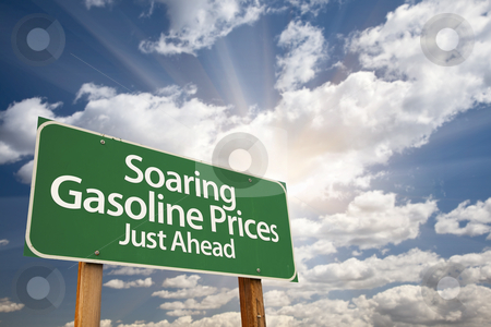 Soaring Gasoline Prices Green Road Sign and Clouds stock photo, Soaring Gasoline Prices Green Road Sign with Dramatic Clouds, Sun Rays and Sky. by Andy Dean