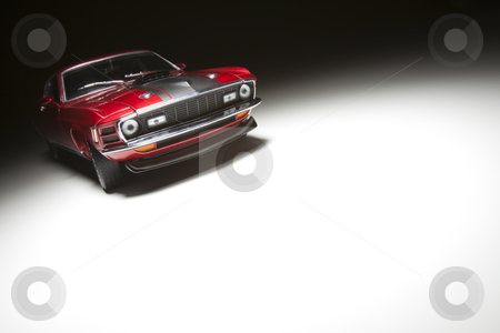 Sports Car on White Under Spot Light stock photo, Muscle Sports Car on White Under Spot Light. by Andy Dean