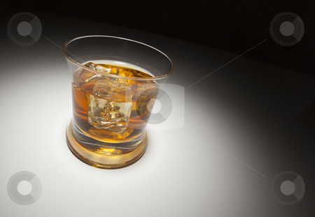 Glass of Whiskey and Ice Under Spot Light stock photo, Glass of Whiskey or Other Alcoholic Drink and Ice Under Spot Light. by Andy Dean