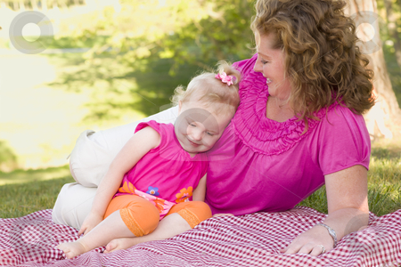 Mother and Daughter on Blanket in the Park stock photo, Loving Moment with Attractive Mother and Adorable Daughter on Picnic Blanket in the Park. by Andy Dean