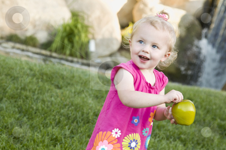 Smiling Young Girl in The Park Holding Apple stock photo, Adorable Smiling Young Girl in The Park Holding Green Apple. by Andy Dean