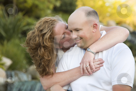 Attractive Couple Kiss on the Cheek in the Park. stock photo, Happy, Attractive, Affectionate Couple Kiss on Cheek in the Park. by Andy Dean