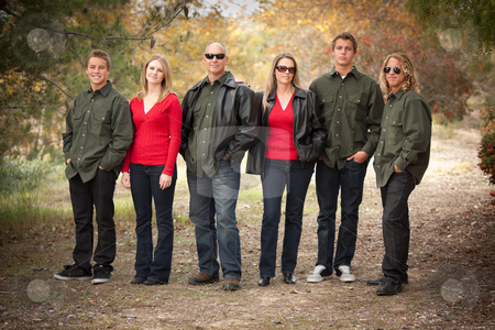 Attractive Family Portrait Walking Outdoors stock photo, Happy Attractive Family Standing Portrait Outdoors. by Andy Dean