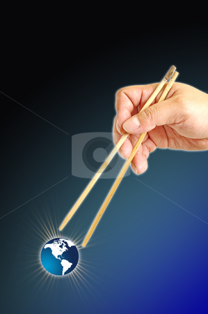 Hand and icon world stock photo, The earth between two chopsticks by phanlop88