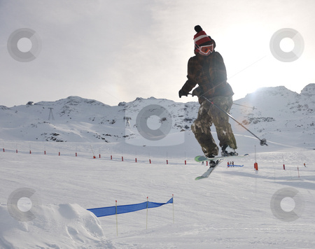 Extreme freestyle ski jump stock photo, extreme freestyle ski jump with young man at mountain in snow park at winter season by Benis Arapovic