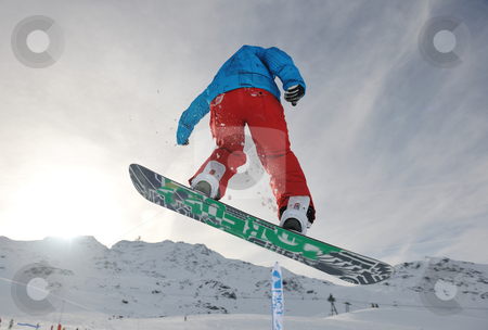 Snowboarder extreme jump stock photo, snowboard winter sport  extreme jump  by Benis Arapovic