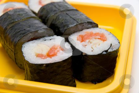 Close up of sushi roll stock photo, Close up of sushi roll on yellow plate by olinchuk