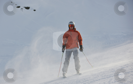  skiing on on now at winter season stock photo, young athlete man have fun during skiing sport on hi mountain slopes at winter seasson and sunny day by Benis Arapovic