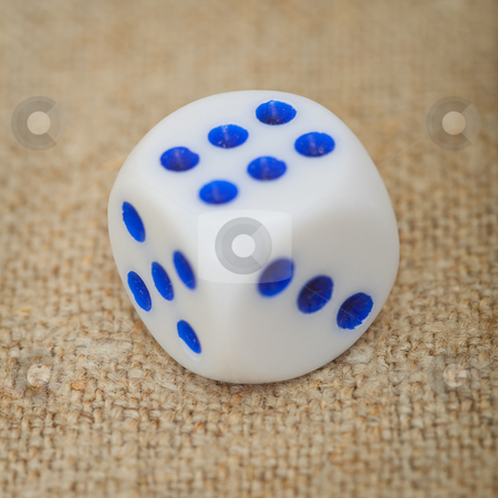 Plastic dice with blue dots on canvas close up stock photo, Grey plastic dice with blue dots on a canvas close up by Alexey Romanov