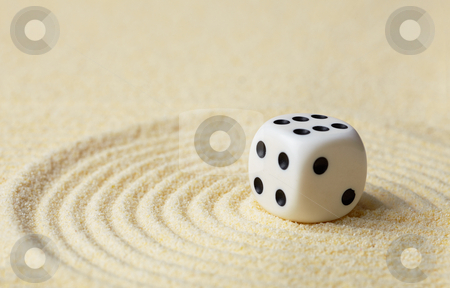 Dice with against yellow sand stock photo, Dice with black dots against yellow sand by Alexey Romanov