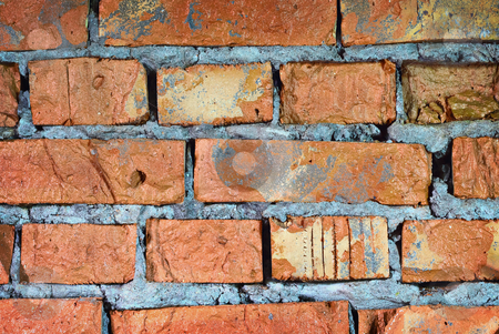 Brick wall of ancient stone castle stock photo, The brick wall of an ancient stone castle closeup by Alexey Romanov