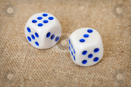 Two playing dices with blue points on brown canvas stock photo, Two playing dices with dark blue points lie on a brown canvas by Alexey Romanov