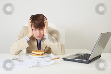 Young man was going to eat sandwich stock photo, The young man was going to eat a sandwich by Alexey Romanov