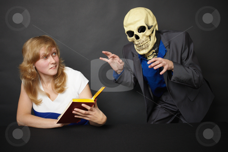 Hallucination stock photo, A young woman experiences hallucinations - funny skeleton by Alexey Romanov