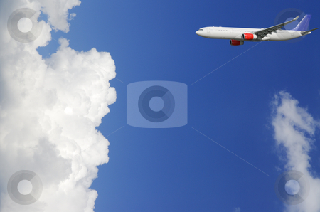 Airliner flying into clouds stock photo, airliner flying into puffy cloud-scape, clear blue sky by lagereek