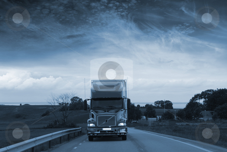 Truck driving at night stock photo, truck driving at night, dark blue sky and scenery by lagereek
