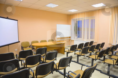Modern interior of a conference hall in pink tones stock photo, Modern interior of a small conference hall in pink tones by Alexey Romanov