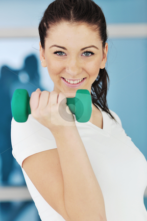 Woman fitness workout with weights stock photo, beaudiful young woman fitness workout with weights at sport club by Benis Arapovic
