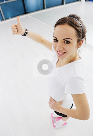 Happy diet concept with young woman on pink scale stock photo, happy diet concept with young woman on pink scale at sport fitnes gym club by Benis Arapovic