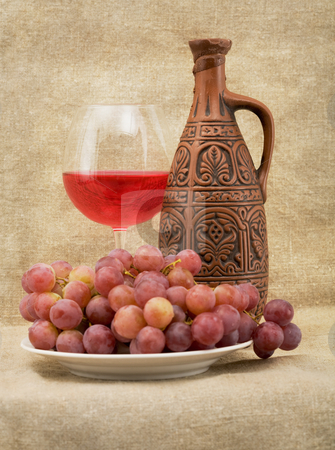 Bright still life with wine stock photo, Bright still life with grapes and wine on sacking background by Alexey Romanov