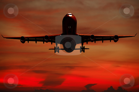 Air travel - Silhouett of plane and sunset stock photo, Plane is flying while the sun is setting by Lars Christensen
