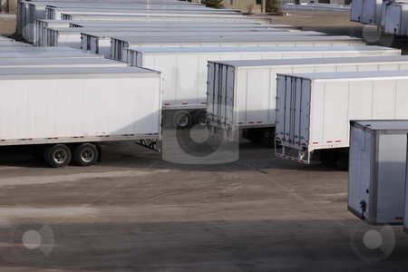 Lots of Parked Trailers stock photo, A parking lot with lots of transport trucks and trailers.  by Chris Hill