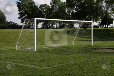 Vacant Soccer Goal at Dusk stock photo, A view of a net on a vacant soccer pitch.  by Chris Hill