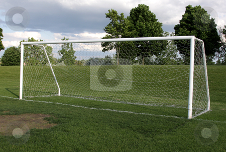 Open Soccer Net stock photo, A view of a net on a vacant soccer pitch.  by Chris Hill