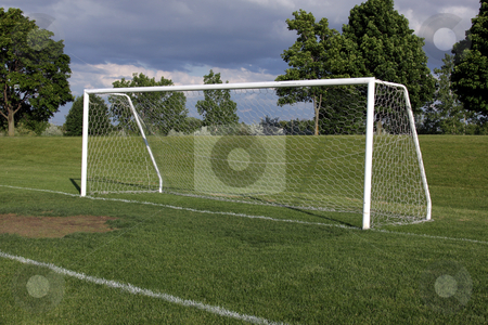 Soccer Goal stock photo, A view of a net on a vacant soccer pitch.  by Chris Hill