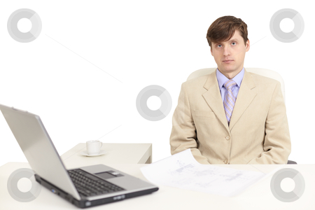 Young serious person on a workplace stock photo, The young serious person on a workplace with the laptop by Alexey Romanov