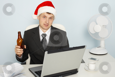 Businessman meets new year still working stock photo, Businessman meets the new year still working in office by Alexey Romanov