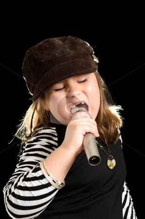 Child Pop Star stock photo, A young girl is singing like a pop star, isolated against a black background. by Richard Nelson