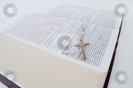 Rosary Laying on Open Bible Corner stock photo, Low angle shoot of Rosary laying on near corner of an open Bible by Michael T