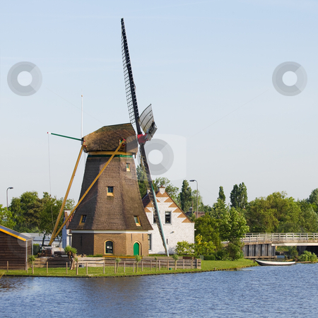 Dutch windmill, house and bridge stock photo, Dutch windmill, house and bridge at the waterside - square by Colette Planken-Kooij